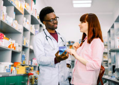 pharmacist talking to an adult woman